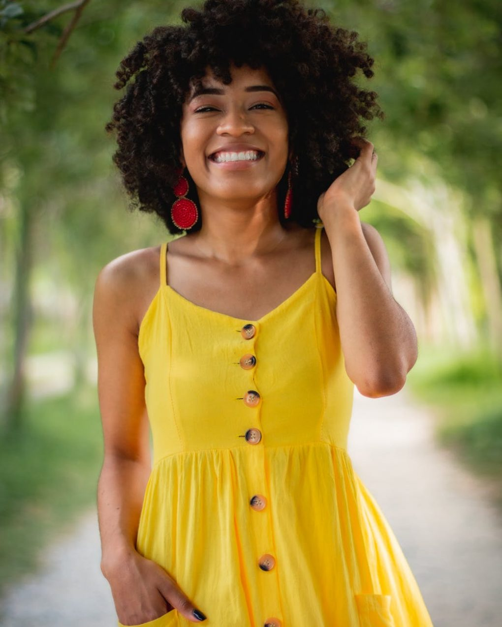 girl with smile in a lemon yellow maxi dress
